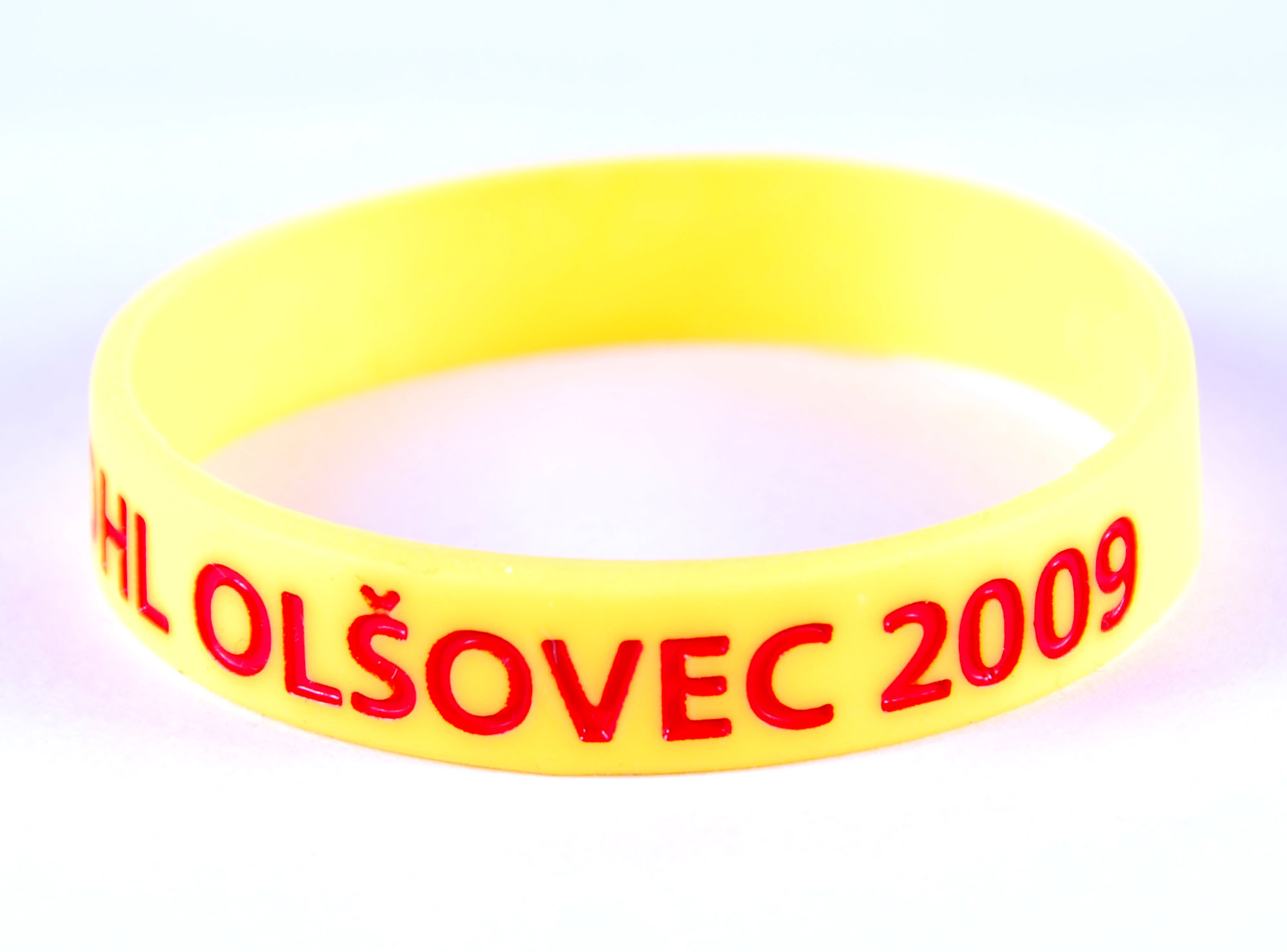 Custom yellow silicone bands with debossed logo and color fill i