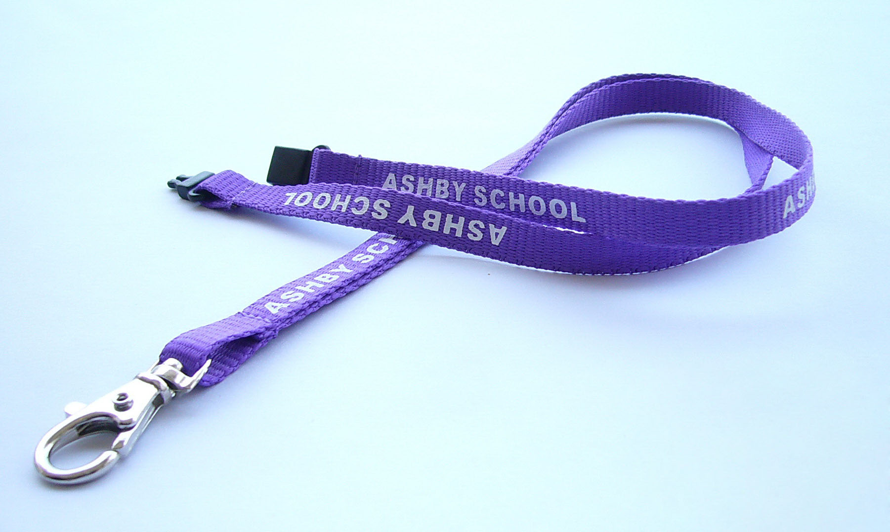 Polyester lanyard with safety breakaway