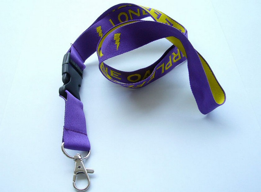 Woven lanyard with plastic safety release buckle