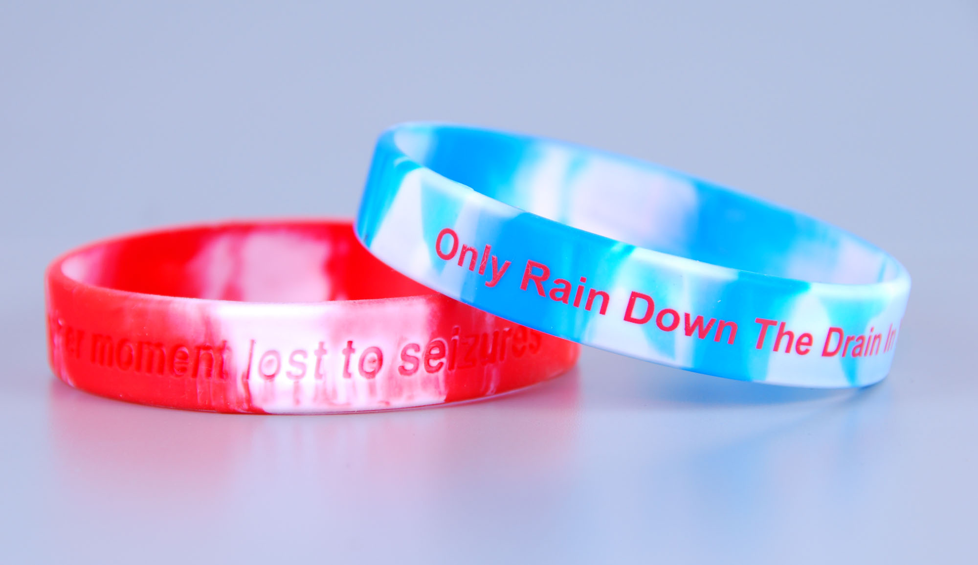 Custom segmented siclcone wristbands with debossed logo